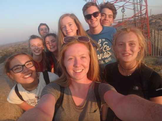 A group selfie on top of the highest point in Old Shinyanga