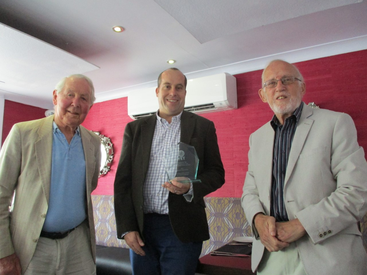 Photo of David Williams being presented with the award by Mike Cross and Ted Grey